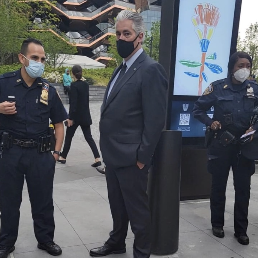 Two NYPD officers flanking a Hudson Yards security guard earlier this week. Vendors allege the developer instructed the cops to issue the tickets