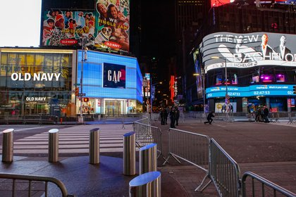 Empty Times Square is set up for the New Year's festivities, with barriers and no crowds