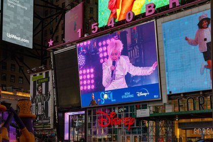 Cyndi Lauper is seen in a monitor