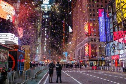 Confetti falls into the empty street