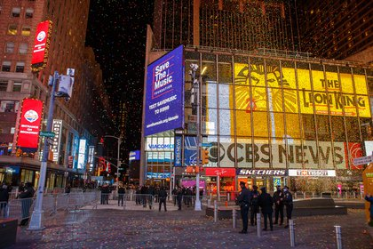 A relatively empty Times Square with confetti in the air