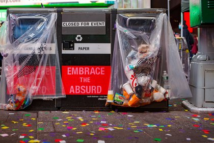 """A garbage can that says """"Embrace the Absurd"""""""