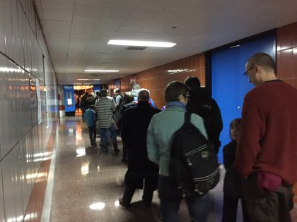 The line to vote inside LaGuardia High School was long outside and inside this morning. (Jen Chung / Gothamist)