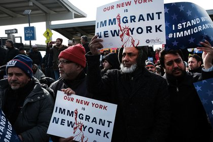 Muslim men demonstrate JFK airport to protest President Donald Trump's immigration ban, February 3, 2017 <br>