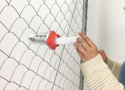 Shaya al Arfaj imagined distributing information fences as well as through water bottles placed in a fence<br>