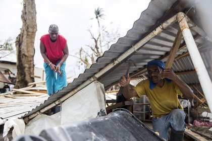 Residents dismantle a roof days after Hurricane Maria made landfall, Friday, September 22 in Loiza, Puerto Rico. (Alex Wroblewski/Getty Images)