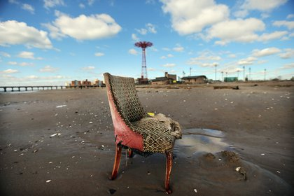 A damaged chair sits on the beach in low-lying Coney Island in the wake of Superstorm Sandy on November 3, 2012. <br/>