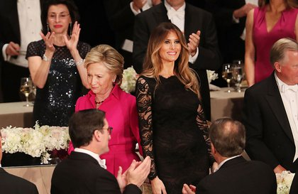 Clinton and Trump's wife Melania share a tender moment of forced proximity. <br/>