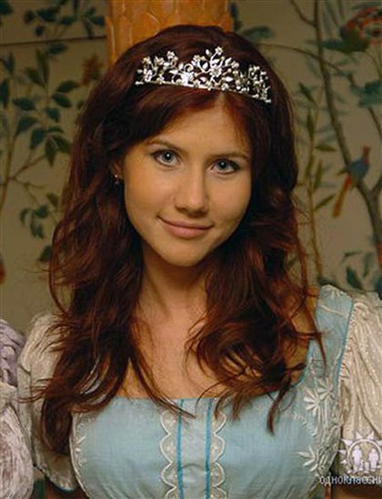 """Anna Chapman, from her Odnoklassniki (""""Classmates"""") page. The caption reads """"Russia, Moscow. London, Stone age."""""""