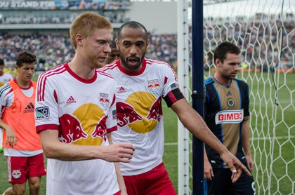 Thierry Henry chats with Markus Holgersson heading into the locker room.