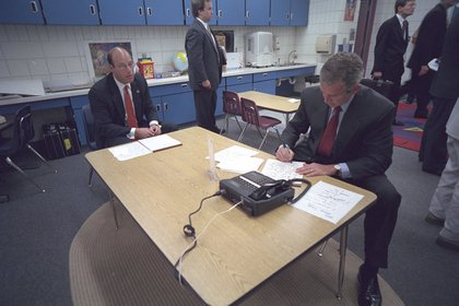 Bush and Press Secretary Ari Fleischer in a holding room at the school. </br>