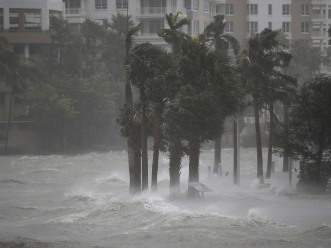 Water flows out of the Miami River to flood a walkway as Hurricane Irma passes through on September 10, 2017 in Miami, Florida (Getty Images)