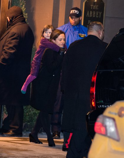 O'Donnell carrying Willa out of the funeral home (Getty Images)