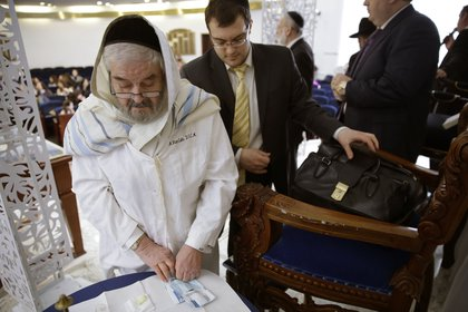 Abraham Romi Cohn, left, prepares his implements for a bris, or ritual circumcision, in New York. Mayor Bill de Blasio's administration is negotiating a medical protocol that would allow for religious freedom as it navigates health officials' concern over the practice of oral suction during ultra-Orthodox circumcision ceremonies<br/>