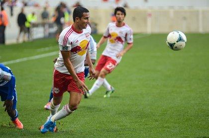 Tim Cahill controls the ball during second half play. Kosuke Kimura looks on.