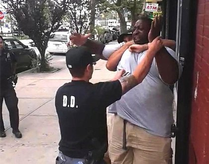 A still from the video showing police officers trying to arrest Garner<br/>