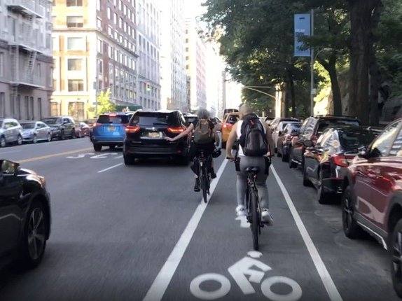 Cyclists riding up to last night's community board meeting, forced into traffic by a cab blocking the painted bike lane on Central Park West.
