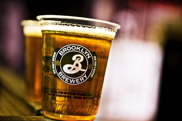 A photo of a pint glass with the Brooklyn Brewery logo.