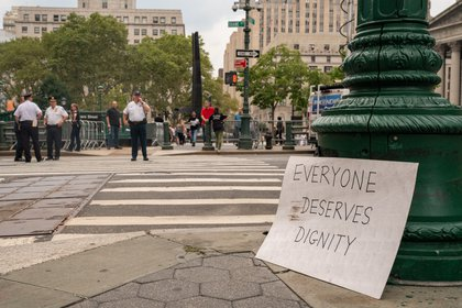 """Everyone Deserve Dignity"" sign left at Foley Square<br>"