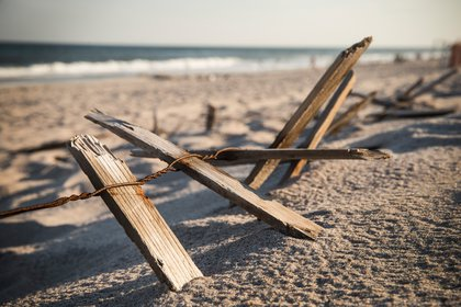 Pieces of a fence remain along the dunes at Smith Point Beach, near the TWA 800 International Memorial, which is dedicated to the 230 people who died from an explosion on flight TWA 800 in 1996<br/>