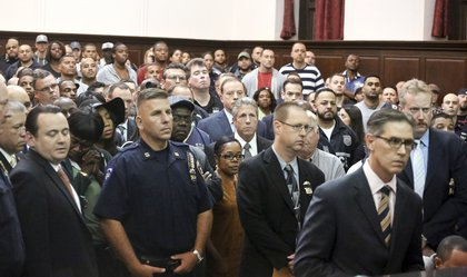Police officers crowd the courtroom<br>