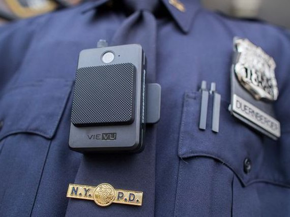 A police officers wearing the Vievue mode LE-4 body camera office outside the 34th precinct