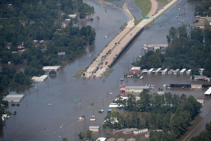 A road is covered by floodwater left in the wake of Hurricane.<br>