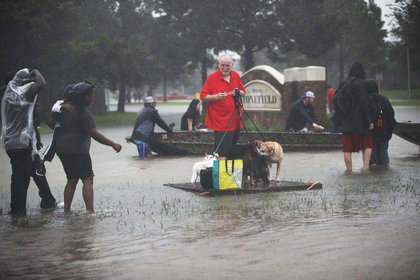 : People wait for a rescue boat as they flee their homes after the area was inundated with flooding from Hurricane Harvey on August 28, 2017 in Houston, Texas<br>(Getty Images)
