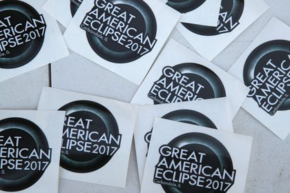 A vendor sells solar eclipse stickers on August 19, 2017 in Carbondale, Illinois.<br>