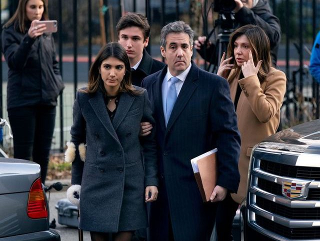 Michael Cohen accompanied by his children and wife arriving at federal court for his sentencing on Wednesday