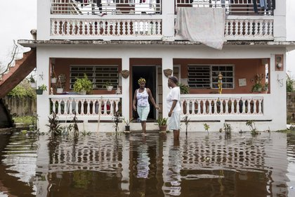 Residents wade through flood waters at their home days after Hurricane Maria made landfall, on Friday, September 22nd in Loiza, Puerto Rico. (Alex Wroblewski/Getty Images)