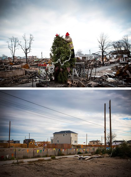 Edward 'Roaddawg' Manley, a volunteer and honory firefighter with the Point Breeze Volunteer Fire Department, places a star on top of a Christmas tree December 25, 2012 in the Breezy Point neighborhood of Queens