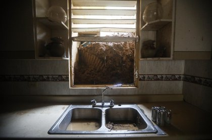 Mud from a landslide blocks the kitchen window of the Reyes family more than two weeks after Hurricane Maria hit the island, on October 9, 2017 in Jayuya, Puerto Rico. <br/>