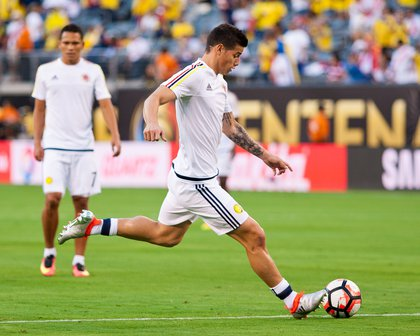 Colombia midfielder James Rodriguez warms up before the match.