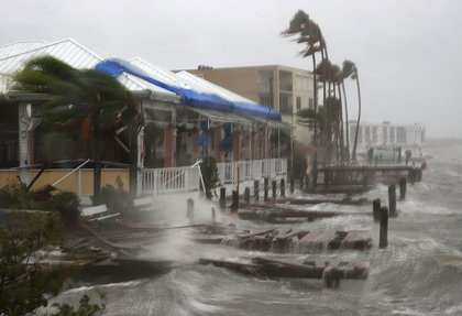 Heavy waves caused by Hurricane Matthew pounds the boat docks at the Sunset Bar and Grill, October 7, 2016 on Cocoa Beach (Getty Images)