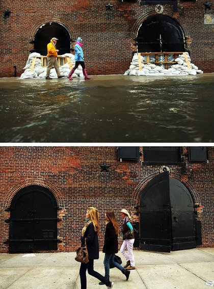 [Top] People walk past sandbags on a flooded street as Hurricane Sandy moves closer to the area on October 29, 2012 in the Red Hook section of the Brooklyn borough of New York City. [Bottom People walk past the same building on October 23, 2013.(Getty Images)