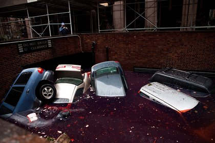 Cars floating in a flooded subterranean basement following Hurricane Sandy on October 30, 2012 in the Financial District. <br/>