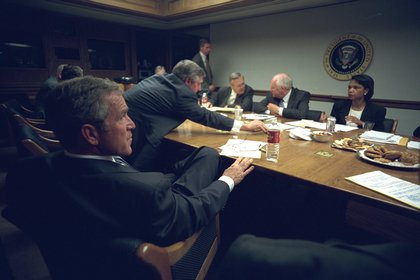 Bush meets with Secretary of Defense Donald Rumsfeld, Vice President Dick Cheney, National Security Adviser Condoleezza Rice, and White House Chief of Staff Andrew Card after addressing the nation. </br>