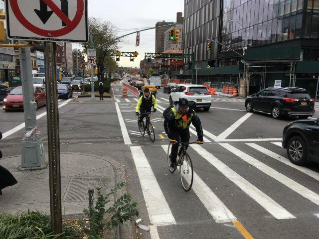 The new two-way Delancey Street protected bike lane in action last month