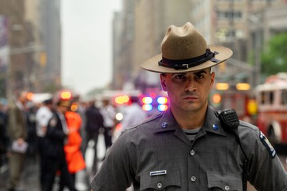 "A state police officer at the scene  (David ""Dee"" Delgado /  Gothamist)"