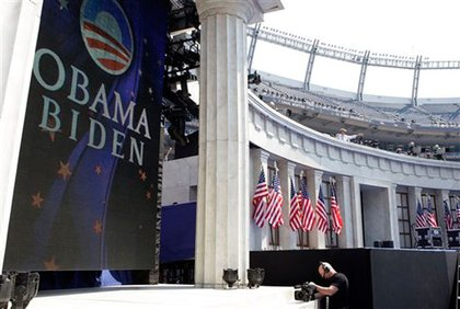 Finishing touches on the stage at Invesco Field.