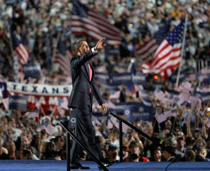 Obama walks out and waves to his supporters.