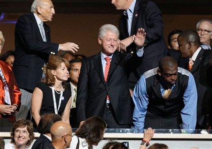 Former President Bill Clinton waves