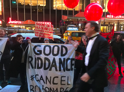 Protesters confront one of the gala attendees, who shouts back at them (Gothamist)