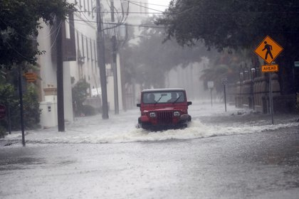 A motorist drives down flooded street in St. Augustine (AP)
