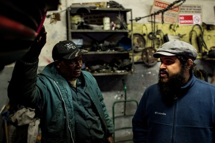 Monxo Lopez visits his friend Seth Anum at the auto body shop where Anum works as a mechanic. The shop is just around the corner from Monxo's house.