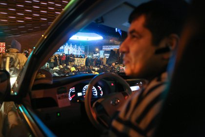A cab driver seems more amused than annoyed at the fact that he was prevented from accessing Atlantic Avenue due to the protest and had to reverse down the street.<br>