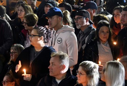 Family members and friends gather for a candlelight vigil memorial at Mohawk Valley Gateway Overlook Pedestrian Bridge in Amsterdam, N.Y., . The memorial honored 20 people who died in Saturday's fatal limousine crash in Schoharie, N.Y<br>