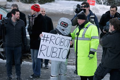 With the Robot Police.<br>
