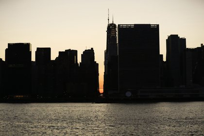 The sun set behind the darkened buildings on July 13, 2019 (Vanessa Carvalho/Shutterstock)